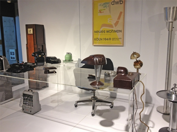 Glass desk with vintage objects