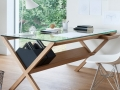 Glass desk with criss cross wooden legs