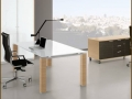 Glass desk with light wood legs