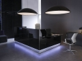 black glossy reception desk