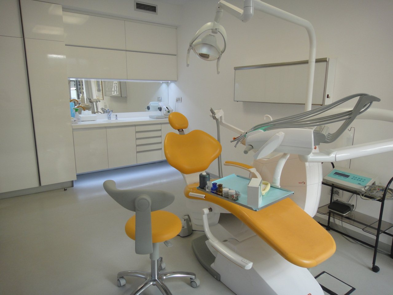 Orange Chair In Dental